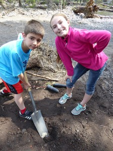 Clay Warburton's class plants trees along Whychus Creek.